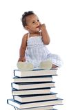 Baby on a book tower Royalty Free Stock Images