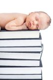 Baby and books. Lovely baby sleep on pile of books Royalty Free Stock Photo