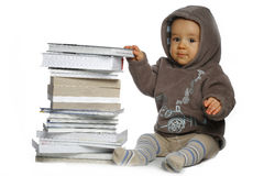 Baby with  books. A small baby wearing hood with  books Royalty Free Stock Photography