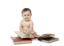 Baby with the books Stock Images