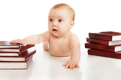 Baby and books. On the white background Royalty Free Stock Image