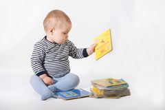Baby and books stock photo