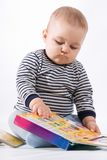 Baby and books Stock Images