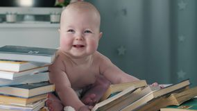 Baby with the books stock footage