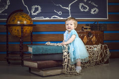 Baby with books and globe Royalty Free Stock Images