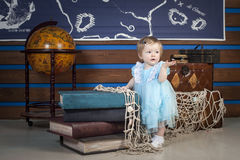 Baby with books and globe Royalty Free Stock Photography