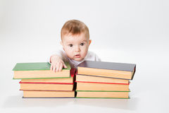 Baby and Books. Kids Early Childhood Education Development, Smart Child Preschool Reading Concept, over White Background Stock Photos