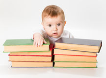 Baby and Books Stock Image