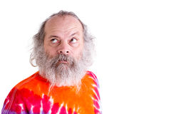 Baby Boomer with his Tie Dye T-Shirt, Thoughtfully Looking up Se Royalty Free Stock Photos