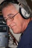 Baby boomer loving music Royalty Free Stock Image