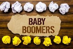 Baby boomers conceptuelles de mot des textes de main Concept d'affaires pour la génération démographique écrite sur la note colla Image stock