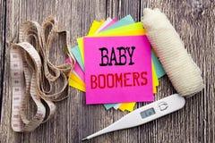 Baby boomers des textes d'annonce d'écriture Concept de santé de forme physique d'affaires pour la note collante écrite par génér photographie stock