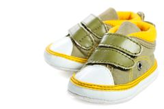 Baby bootee. Green baby shoes on white background Stock Image