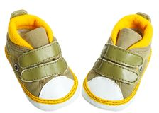 Baby bootee. Green baby shoes isolated on white background Stock Photography