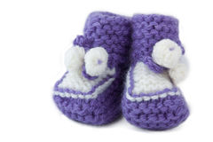 Baby bootee. Pair of violet baby bootees Stock Image