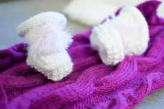 Baby bootees. Cute baby bootees on the knitting Stock Photos