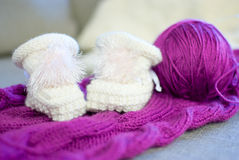 Baby bootees. Cute baby bootees on the knitting Stock Image