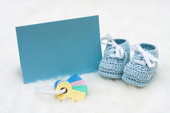 Baby Booties. With a blank card sitting on a white background stock photos
