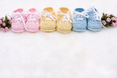 Baby Booties. Three pairs of baby booties on a white background royalty free stock photography