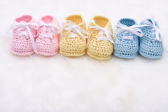 Baby Booties. Three pairs of baby booties on a white background royalty free stock images