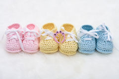 Baby Booties. Three pairs of baby booties on a white background royalty free stock photos