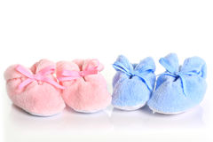 Baby booties. Pink and blue baby booties stock images