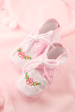 Baby booties. Little baby girls pink booties appropriate for newborn stock photography
