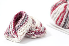Baby booties. A pair of knitted baby booties on white background Royalty Free Stock Photography