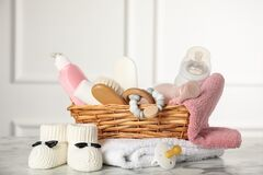 Free Baby Booties And Accessories On White Marble Table Indoors Stock Photography - 220547252