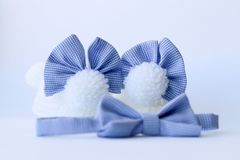 Baby booties with bows and bow tie royalty free stock images