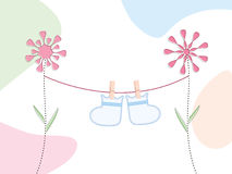 Baby booties card. Baby booties hanging on a clothesline suspended from retro flowers stock illustration