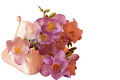 Baby booties and freesias isolated Royalty Free Stock Photo