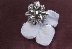 Baby Booties Given to Expectant Grandparents Royalty Free Stock Photos