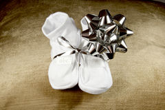 Baby Booties Given to Expectant Grandparents Stock Photo