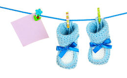 Baby booties hanging Royalty Free Stock Image