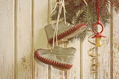 Baby booties and nipple hanging on christmas tree Royalty Free Stock Photography