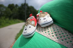 Pregnant Belly Baby Booties Stock Photo