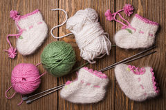 Baby booties with their hands Stock Photography
