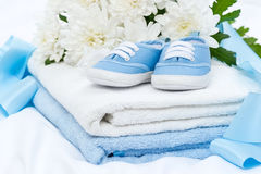 Baby booties and towel Stock Photography