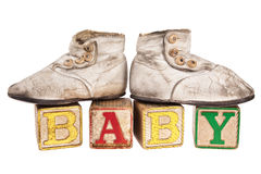 Baby booties on vintage blocks Royalty Free Stock Images