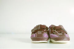 Baby booties on a white wood. Copy space Stock Image