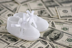 Baby boots on money Stock Photography