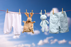 Baby is born   Boy or a girl on the outdoor clothesline Stock Photos