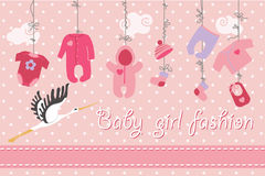 Baby born clothes hanging on the tree.Baby boy fashion. Colorful clothes for newborn baby girl hanging on the rope on polka dot background. Design template Royalty Free Stock Photo