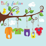 Baby born clothes hanging on the tree.Baby fashion. Colorful clothes for newborn baby hanging on the rope in the tree branches. Baby fashion.Slip,body,jacket Stock Photos