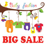 Baby born clothes hanging on the tree.Big sale. Colorful clothes for newborn baby hanging on the rope in the tree branches. Baby born clothes hanging on the tree Stock Photos