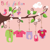 Baby born clothes hanging on the tree. Colorful clothes for newborn baby girl hanging on the rope in the tree branches. Baby fashion.Slip,body,jacket,sliders Royalty Free Stock Photography