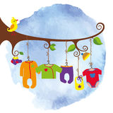 Baby born clothes hanging on the tree. Colorful newborn baby clothes hanging on rope in the tree branches. Baby fashion for girls,boys , unisex Stock Illustration