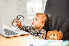 Baby boss at the office stock images