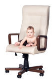 Baby boss sits in office chair on white Stock Photography